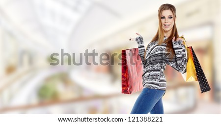 Beautiful shopping woman at a draw mall - stock photo
