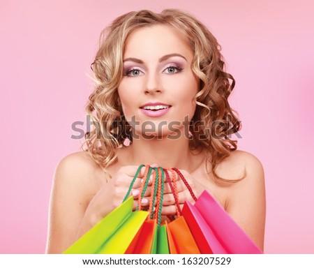 Beautiful shopping woman happy holding shopping bags - stock photo
