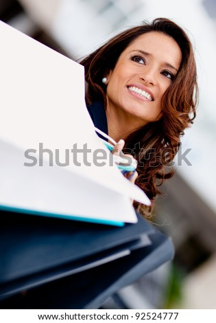 Beautiful shopping woman holding bags and smiling - stock photo