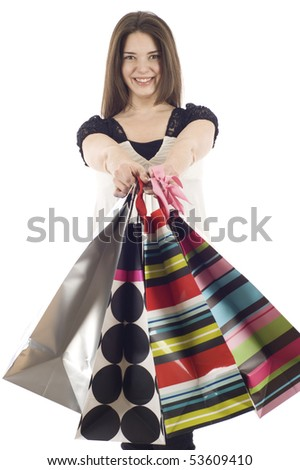Beautiful shopping woman isolated over a white background - stock photo