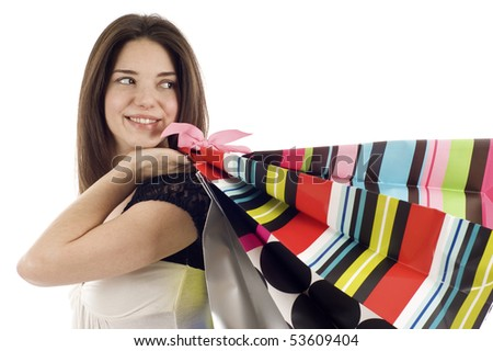 Beautiful shopping woman, she's looking at the copyspace, isolated over white background