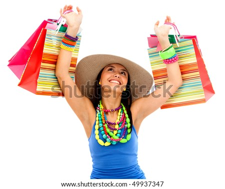 Beautiful shopping woman smiling and wearing a hat - isolated over white - stock photo