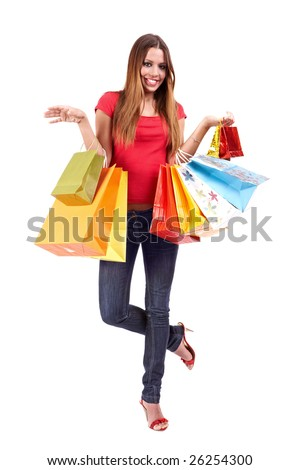 Beautiful shopping woman with colorful bags. - stock photo