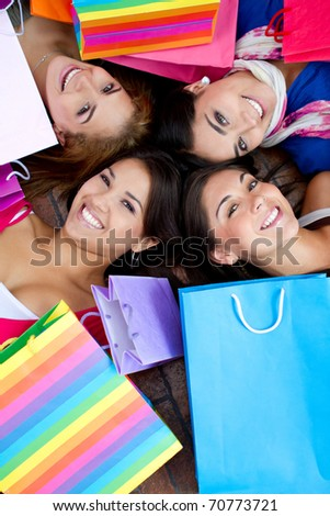 Beautiful shopping women with bags and smiling - stock photo