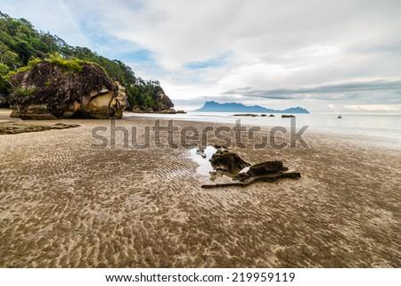 Beautiful shoreline and dramatic sky from Bako National Park, West Sarawak, Borneo, Malaysia. - stock photo