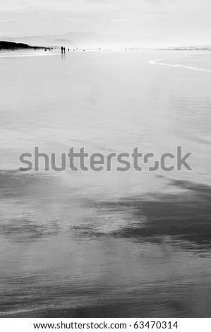 beautiful shoreline, wide beach, just enough water to cover the sand and create reflections, San Francisco - stock photo