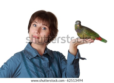 beautiful short hair middel age woman holding a green pionus parrot, white background - stock photo