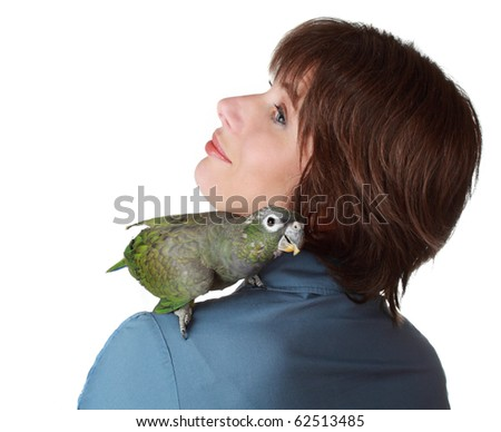 beautiful short hair middel age woman with a pionus parrot on her shoulder, isolated on white - stock photo