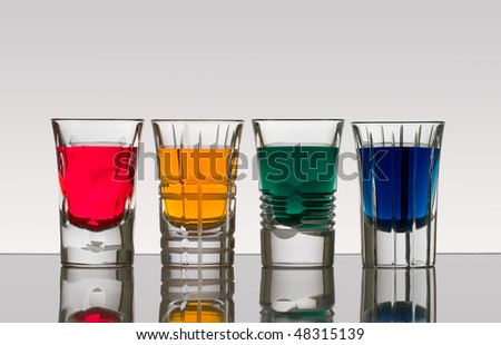 Beautiful shot glasses back lit - stock photo