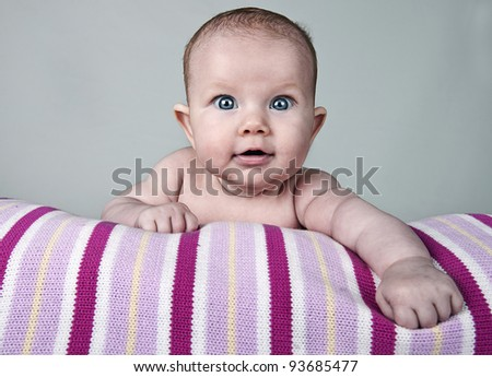 Beautiful Shot of a Pretty Baby Girl Smiling - stock photo
