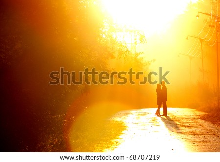beautiful shot of kissing couple in the sunlight - stock photo