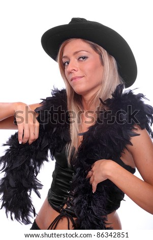 Beautiful showgirl in retro costume with cowboy hat and black boa. - stock photo