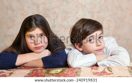 beautiful siblings couple boy and elderly girl - stock photo