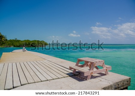 beautiful sight of wooden dock above turquoise water in caye caulker belize caribbean - stock photo