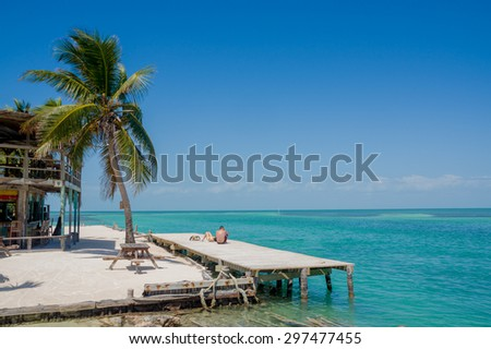 beautiful sight of wooden dock above turquoise water in caye caulker belize caribbean