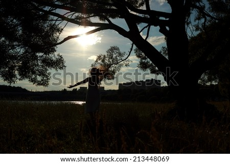 Beautiful silhouette of a little girl at sunset