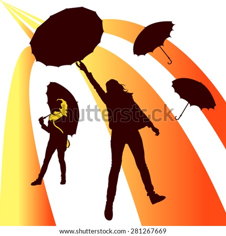 Beautiful silhouettes of girls with umbrellas under the golden rain