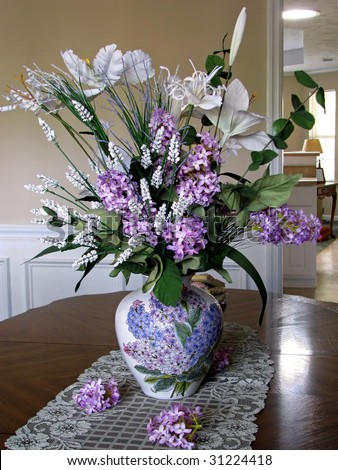 beautiful silk lilac floral arrangement as table centerpiece - stock photo
