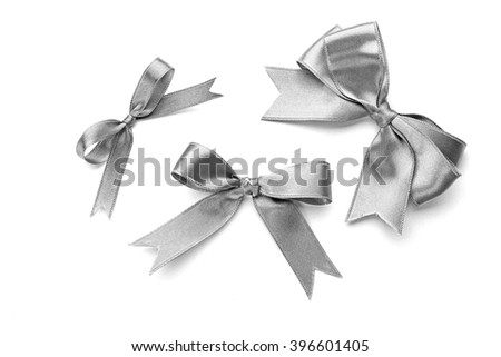 Beautiful silver bows isolated on white background - stock photo