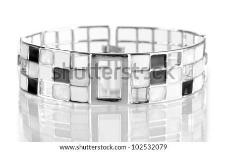 Beautiful silver bracelet isolated on white - stock photo