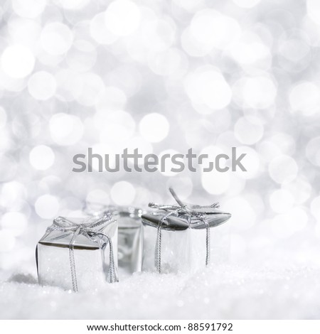 Beautiful silver Christmas decoration with snow in the background - stock photo
