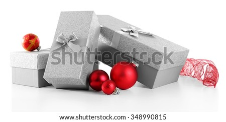 Beautiful silver Christmas gifts with red balls isolated on white background