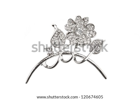 Beautiful silver flower brooch, isolated on white - stock photo
