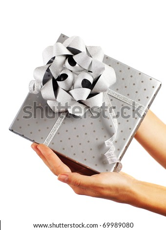 Beautiful silver gift box with female hands isolated on white background - stock photo