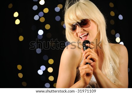 Beautiful singer - stock photo