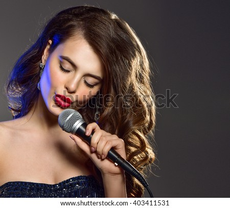 Beautiful Singing Girl. Beauty Woman with Microphone  Glamour Model Singer. Karaoke song