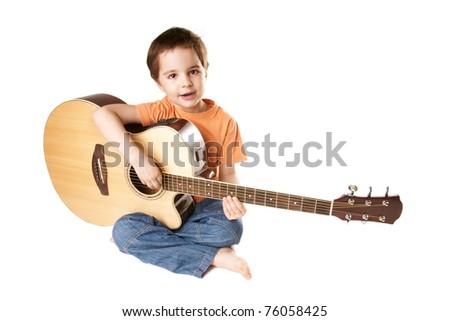 Beautiful singing little boy with acoustic guitar isolated on white background - stock photo