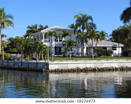 beautiful single residential southern Florida waterfront home - stock photo