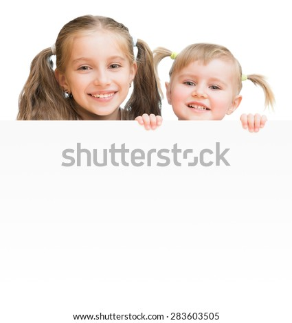 Beautiful sisters with  board isolated on a white background