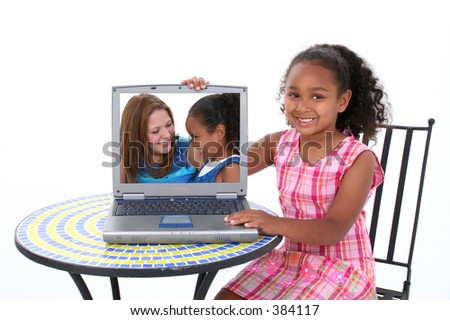 Beautiful Six Year Old Child Showing Off Loved One In Laptop. - stock photo