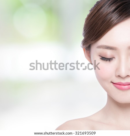 Beautiful Skin care woman enjoy and relax with green background. asian Beauty - stock photo
