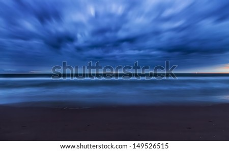 Beautiful sky after sunset seen from the beach - stock photo