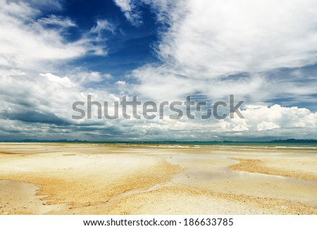Beautiful sky and beach at low tide. - stock photo