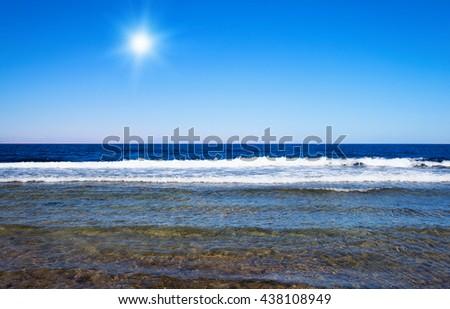 Beautiful sky and blue sea - stock photo