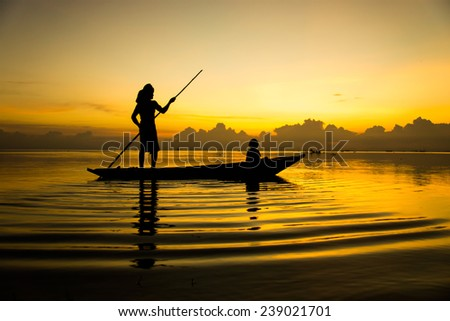 Beautiful sky and Silhouettes of fisherman at the lake, Thailand.