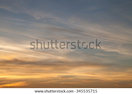 Beautiful sky at sunset, streaked airplane traces. Contrast between warm and cold colors Concept for environmental protection - stock photo