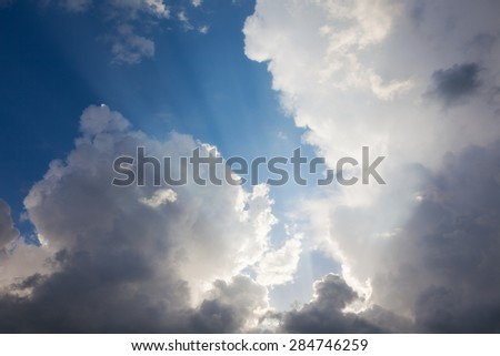 beautiful sky background with clouds and rays