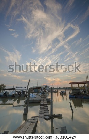 Beautiful sky formation taken at fisherman's village.  Motion Blur, Soft Focus due to Slow Shutter Speed. Copy Space Area.