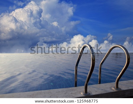 beautiful sky on dusky time at swimming pool - stock photo
