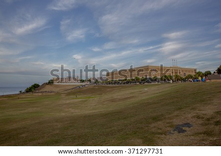 Beautiful sky overlooking the public Museum of the Americas and Fort El Morro in Old San Juan, Puerto Rico. - stock photo