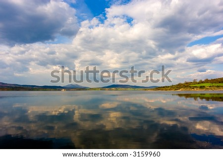 Beautiful sky reflected on calm river waters