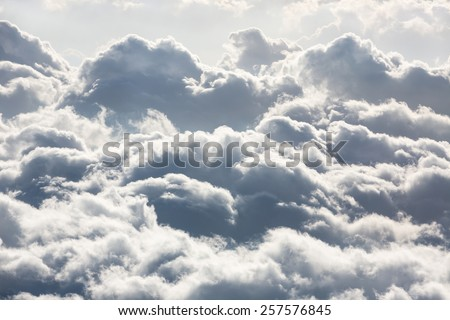 Beautiful sky with clouds, a view from an aeroplane above the clouds - stock photo