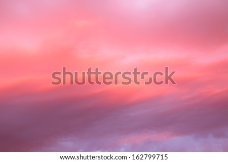 Beautiful  sky with pink and red clouds - stock photo