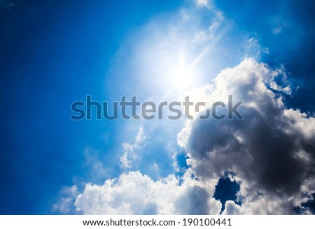 Beautiful  sky with sunbeams and black clouds. Sun rays. - stock photo