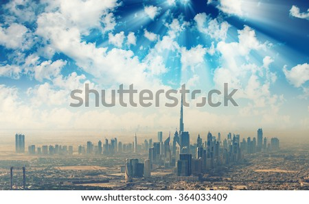 Beautiful skyline of Dubai surrounded by sand dust. - stock photo