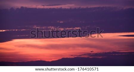 beautiful skyline with an airplane silhouette - stock photo